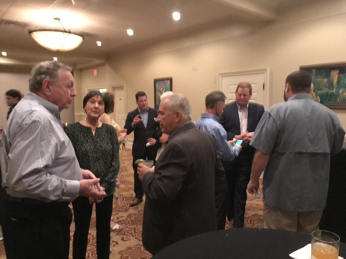 Pat Walsh and Erik Christman speaking with multiple clients at Oxford's 2019 Client Appreciation Event