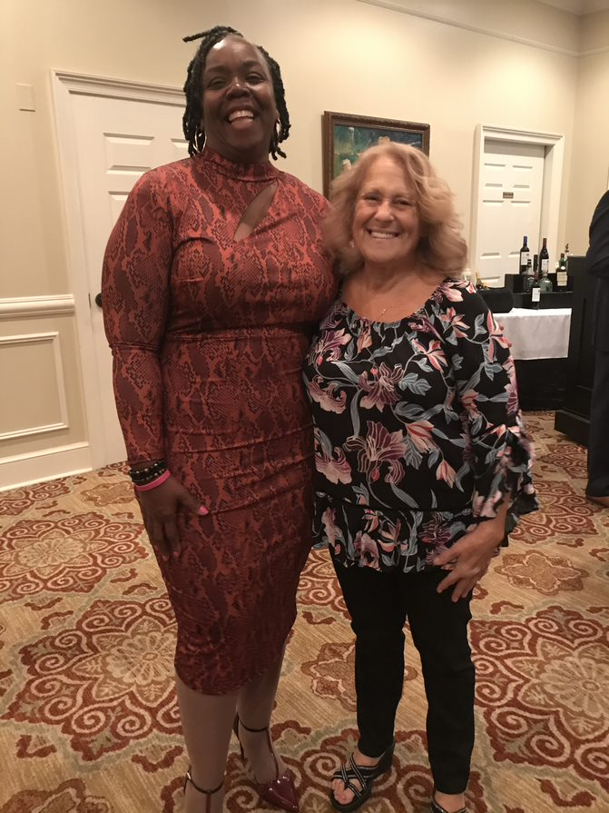 Carolyn Smith smiling with another woman at Oxford's 2019 Client Appreciation Event