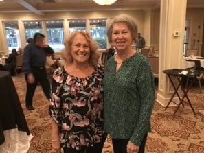 Two older women enjoying their time at the West Lake Country Club