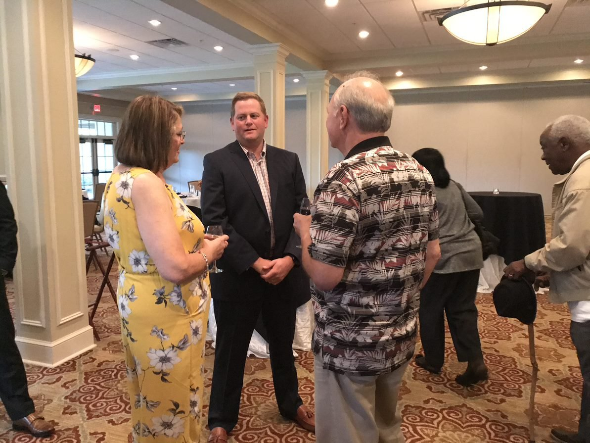 Pat Walsh speaking with an older couple at Oxford's 2019 Client Appreciation Event