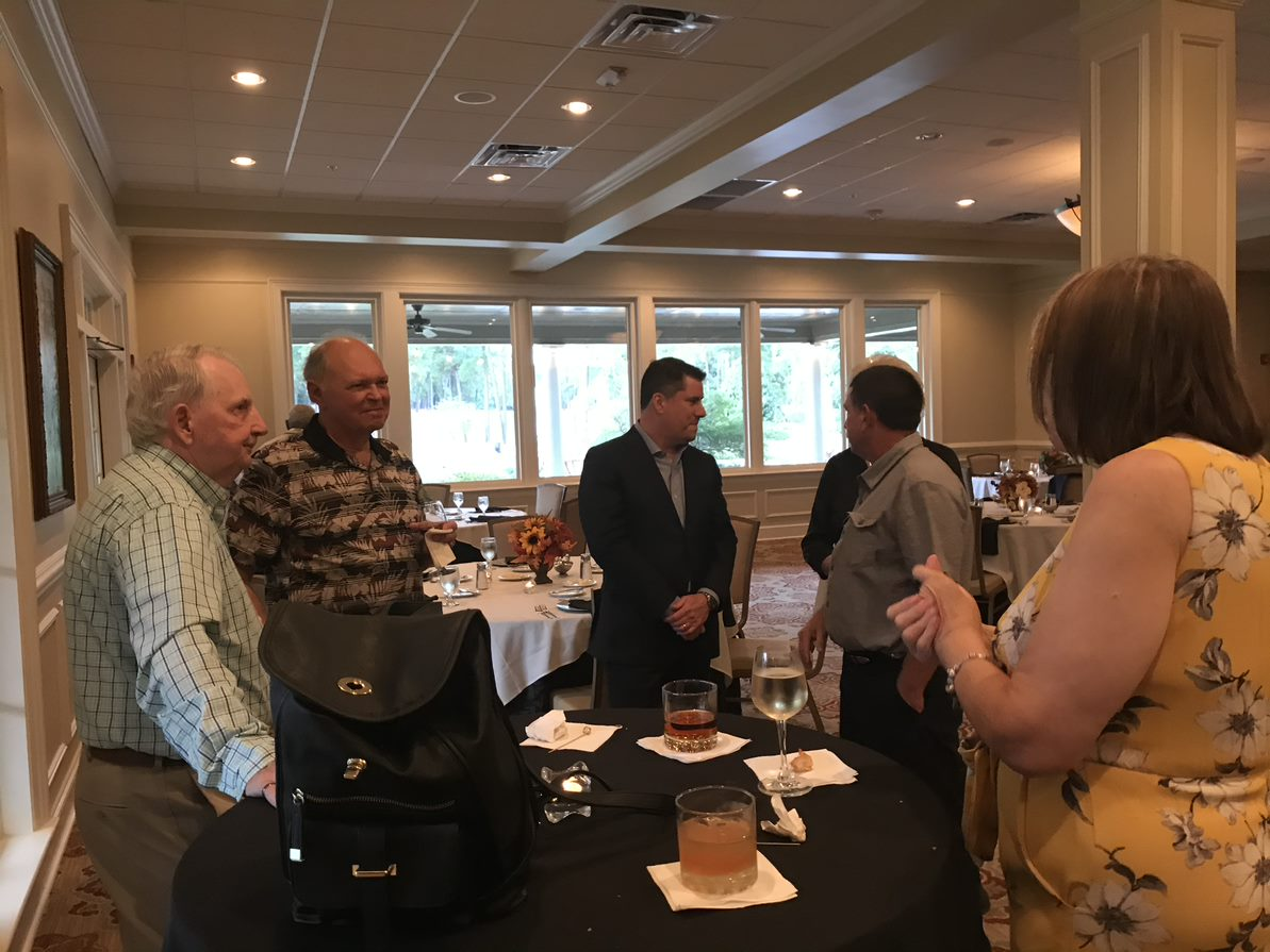 Erik Christman speaking with some clients at Oxford's Client Appreciation Event