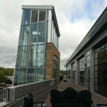 the exterior of a tall glass building at New Riff Distillery in Newport Kentucky